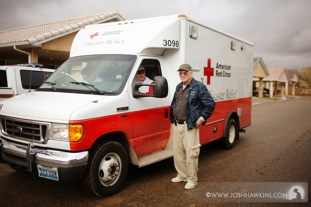 Red Cross disaster assessment teams in Beaver Dam, AZ on December 23rd, 2010 after the flooding the occurred over the previous days...David Lambersaz asks Red Cross members questions