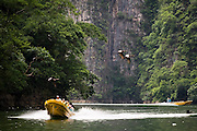 Boat tours take visitors through Sumidero Canyon, a popular tourist destination in Chiapas state, Mexico on June 26, 2008. Lush limestone cliffs rise up to 1000 m (3300 ft) above the Grijalva River as it winds through the dramatic canyon.