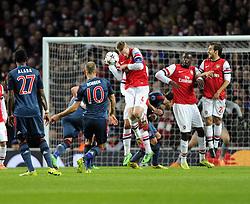 Bayern Munich's Arjen Robben fires his free kick in to the Arsenal  Wall - Photo mandatory by-line: Joe Meredith/JMP - Tel: Mobile: 07966 386802 19/02/2014 - SPORT - FOOTBALL - London - Emirates Stadium - Arsenal v Bayern Munich - Champions League - Last 16 - First Leg