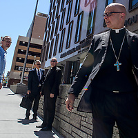 Bishop James S. Wall, right, and other Gallup Catholic Diocese personnel exit the Dennis Chavez Federal Court House following a bankruptcy hearing in Albuquerque Tuesday.