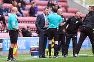 Referee Darren England has words with Southend United Manager Phil Brown. Skybet football league one match , Wigan Athletic v Southend Utd at the DW Stadium in Wigan, Lancs on Saturday 23rd April 2016.<br /> pic by Chris Stading, Andrew Orchard sports photography.