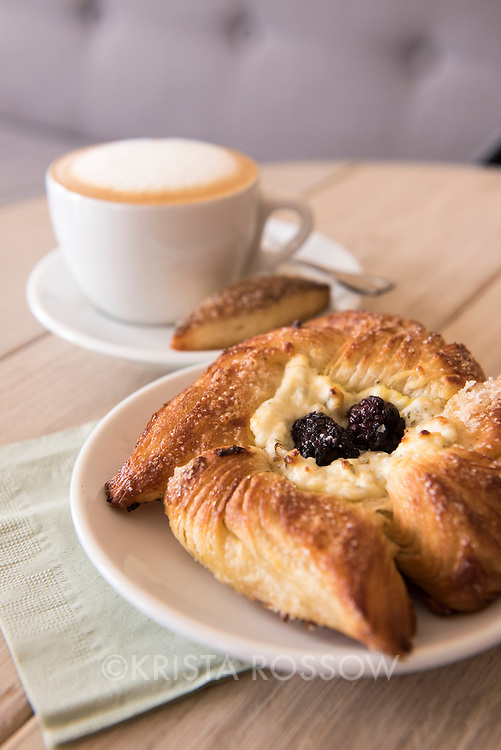 A pastry and coffee at Old World Levain Bakery (OWL), a bakery and coffee shop owned by Susannah Gebhart,  located at 295 Haywood Road in the West Asheville neighborhood of Asheville, North Carolina.