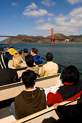 San Francisco, California: Tour boat with tourists near Golden Gate Bridge and Marin Headlands. Photo 15-casanf78234. Photo copyright Lee Foster.