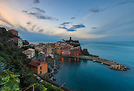 A gorgeous view at sunrise of the Marina and the castle of Vernazza in the Cinque Terre, Italy, as viewed from the Love Trail (Via dell'Amore) towards Monterosso