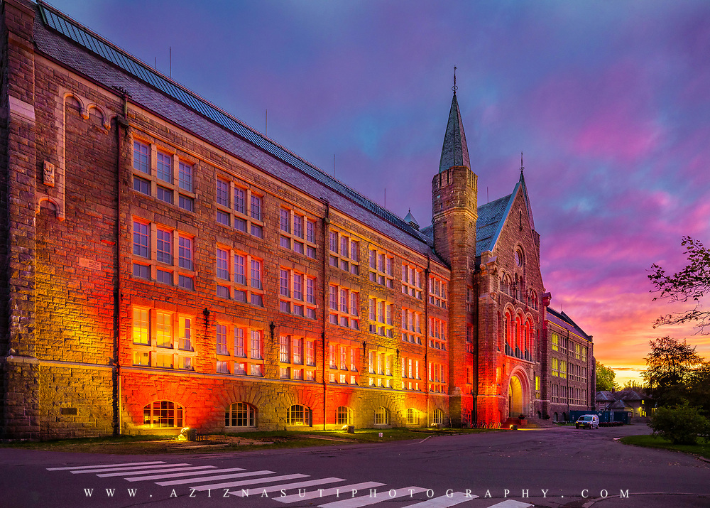 website: www.aziznasutiphotography.com                                            Picture has been taken in a wonderful sunset in Trondheim. The arificial light of the building was matched with the sky. NTNU's main building on Gløshaugen is one of our foremost monumental buildings in stone. It is built in neo-Romanesque style, and if we look we find countless references to medieval churches and castles, not least through the soapstone portal that meets us in the entrance hall|.