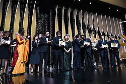 "South Korean director Bong Joon-Ho (3rdL) poses on stage with the Palme d'Or award he received for the film ""Parasite (Gisaengchung)"" as (FromL) a translator, South Korean actor Song Kang-ho, US director and member of the jury of the Cannes Film Festival Kelly Reichardt, French actress Catherine Deneuve, Polish director and member of the jury of the Cannes Film Festival Pawel Pawlikowski, Mexican director and President of the Jury of the Cannes Film Festival Alejandro Gonzalez Inarritu, French director and member of the jury of the Cannes Film Festival Enki Bilal, French director Ladj Ly, holding his Jury Prize for ""Les Miserables"" and British actress Emily Beecham, holding her Best Actress prize for ""Little Joe"" join him on stage on May 25, 2019 at the end of the closing ceremony of the 72nd edition of the Cannes Film Festival in Cannes, southern France. Photo by David Niviere/ABACAPRESS.COM"