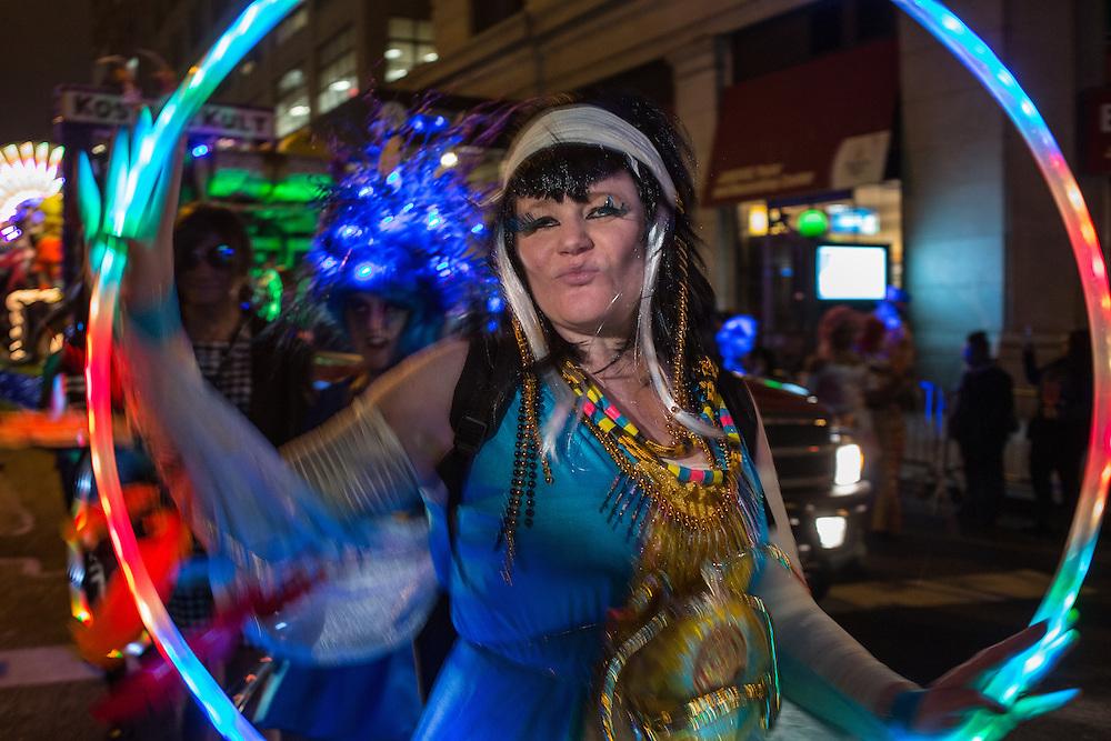 New York, NY, October 31, 2013. A reveler spins an illuminated hoop in New York's Greenwich Village Halloween Parade.
