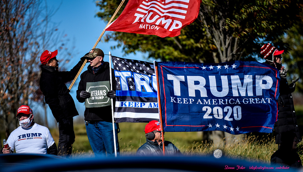 U.S. Sen. Kamala Harris, running mate of Joe Biden, speaks to supporters at Dutch Springs in Bethlehem, Pa., Monday, November 2, 2020. Trump supporters at entrance to rally.