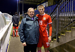 BANGOR, WALES - Tuesday, November 20, 2018: Wales' Lewis Collins poses for a photograph with a family member after a 2-0 victory over San Marino in the UEFA Under-19 Championship 2019 Qualifying Group 4 match between Wales and San Marino at the Nantporth Stadium. (Pic by Paul Greenwood/Propaganda)