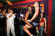 'Eman'--renowned Palestinian draq queen--dances with his Israeli friend during a show in a gay club in Jerusalem--frequented by Israeli and Palestinian drag queens , where the only wall between the people is a dressing room..