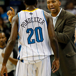 December 21, 2011; New Orleans, LA, USA; New Orleans Hornets head coach Monty Williams talks to small forward Quincy Pondexter (20) during the second half of a preseason game against the Memphis Grizzlies at the New Orleans Arena. The Hornets defeated the Grizzlies 95-80.  Mandatory Credit: Derick E. Hingle-US PRESSWIRE