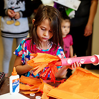 Caydence Montoya, 7, puts the finishing touches on her rocket at the Children's Library launch event for their summer reading program on Wednesday afternoon.