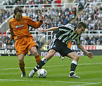Photo. Andrew Unwin.<br /> Newcastle United v Wolverhampton Wanderers, FA Barclaycard Premier League, St James Park, Newcastle upon Tyne 09/05/2004.<br /> Newcastle's Darren Ambrose (r) is stopped by a careful tackle from Lee Naylor (l).