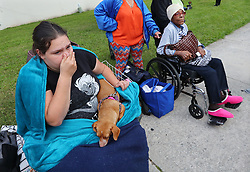 Handicapped local residents Crystal Russell, 22, with her dog Rory, and Frankie Richardson, 70, join hundreds being evacuated from the city at the Savannah Civic Center during a mandatory evacuation for Hurricane Irma on Saturday, September 9, 2017, in Savannah, Ga. Officials are expecting 1,500 to 3,000 without transportation to leave by buses that are being provided. Photo by Curtis Compton/Atlanta Journal-Constitution/TNS/ABACAPRESS.COM