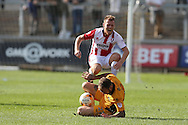 Jack Barthram of Cheltenham Town runs into Sean Rigg of Newport county.  EFL Skybet football league two match, Newport county v Cheltenham Town at Rodney Parade in Newport, South Wales on Saturday 10th September 2016.<br /> pic by Andrew Orchard, Andrew Orchard sports photography.