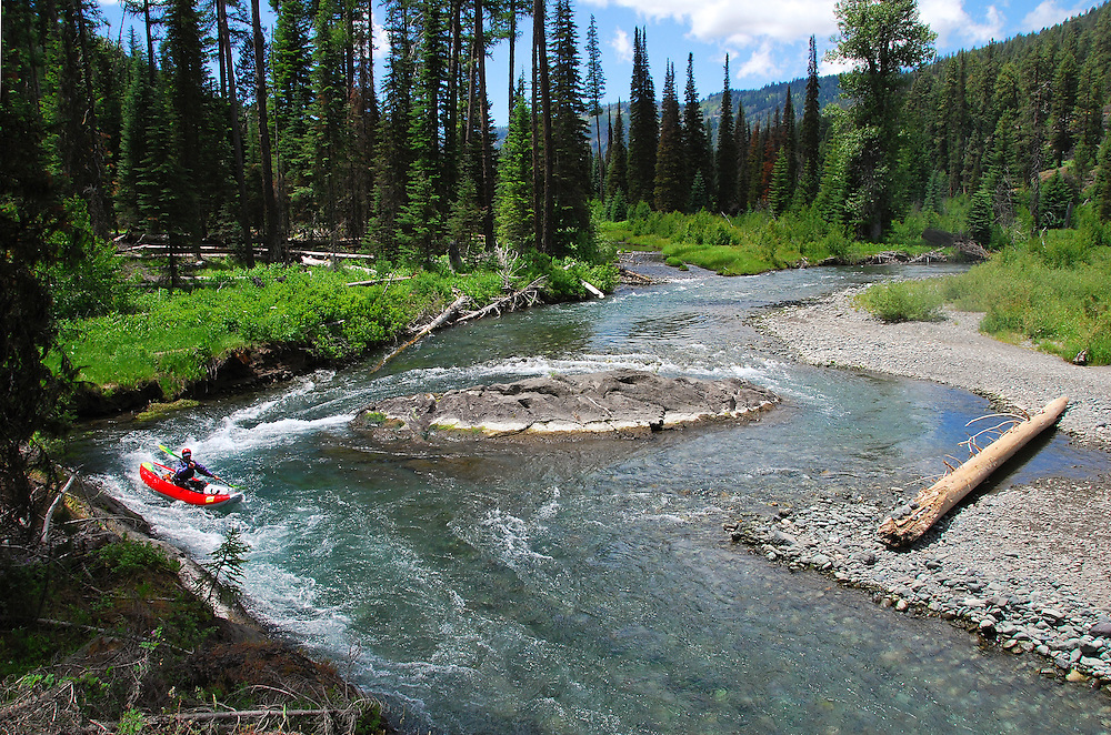 Paddling the upper Imnaha River in an inflatable kayak, Wallowa Mountains, Oregon.