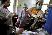 Dr. Zaheera Hamayun, at right, moves the baby shortly after a woman gave birth at Faizabad Provincial Hospital in Badakshan province. Faizabad Hospital's maternity unit has the most advanced facility in Badakshan. However, it also suffers from lack of facilities and staff especially female doctors. Afghanistan has the second highest maternal mortality rate in the world only after Sierra Leone. An astonishing number of 25,000 women die from obstetric causes per year, or 1 woman dies every 27 minutes. A UN report released in 2000 indicates that the national MMR in Afghanistan was 1,900 per 100,000 live births, whereas it was 17 in the United States. Ragh district in Badakshan province showed the highest mortality risk ever recorded in human history, with 64% - more than half of women - of reproductive age died during 1999 and 2002. The causes of deaths were analyzed mainly in two parts: direct and indirect. Direct causes include haemorrhage, obstructed labour, cardiomyopathy, sepsis, obstetric embolism, and pregrancy-induced hypertension; and the indirect causes were tuberculosis, malaria, and obstetric tetanus. Geographical and economical factors also contribute to high mortality in a place like Badakshan where most people have limited access to transportation thus making it harder for women to reach proper health care centers.