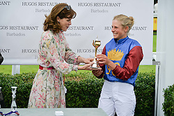 DARCEY BUSSELL presents the Magnolia Cup to Leading GB event rider ISABELLE TAYLOR at day 3 of the Qatar Glorious Goodwood Festival at Goodwood Racecourse, Chechester, West Sussex on 28th July 2016.