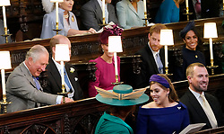 (Centre row left to right) The Prince of Wales, The Duke and Duchess of Cambridge and the Duke and Duchess of Sussex. (front row left to right) Sarah, Duchess of York, Princess Beatrice of York and Peter Phillips take their seats ahead of the wedding of Princess Eugenie to Jack Brooksbank at St George's Chapel in Windsor Castle.