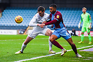 Tom Bayliss of Coventry City (20) and Funso Ojo of Scunthorpe United (6) wrestle for the ball during the EFL Sky Bet League 1 match between Scunthorpe United and Coventry City at Glanford Park, Scunthorpe, England on 5 January 2019.