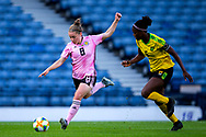 Kim Little (#8) of Scotland prepares to strike the ball as Konya Plummer (#5) of Jamaica attempts to close down during the International Friendly match between Scotland Women and Jamaica Women at Hampden Park, Glasgow, United Kingdom on 28 May 2019.