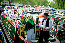 © Licensed to London News Pictures.30/04/2017.London, UK. Two narrowboat owners share a joke as the Canalway Cavalcade festival takes place in Little Venice, London on Saturday, 30 April 2017. Inland Waterways Association's annual gathering of canal boats brings around 130 decorated boats together in Little Venice's canals on May bank holiday weekend. Photo credit: Ben Cawthra/LNP