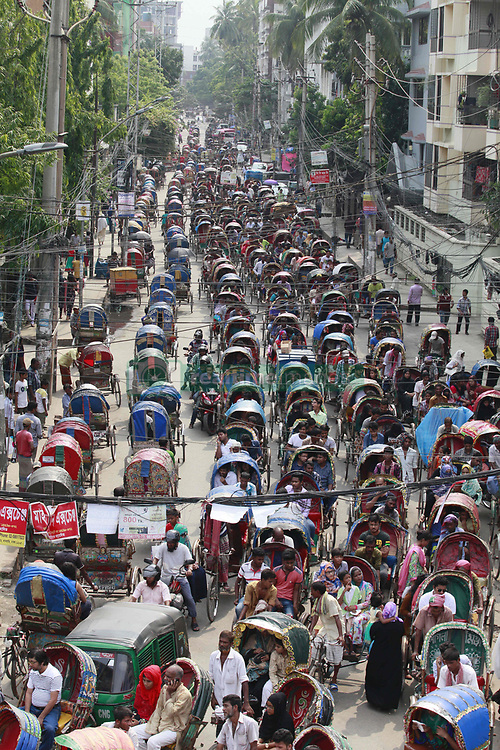 June 18, 2017 - Dhaka, Bangladesh - Hundreds of rickshaws are stuck in a jam on Dhanmondi in Dhaka, Bangladesh, June 18, 2017. Every year this very street sees a high number of the non-motorized vehicle ahead of Eid when the number of illegal rickshaws on city streets increases. About two lakh additional rickshaws have hit the city streets ahead of Eid-ul Fitr, causing massive traffic snarl-ups, with law enforcers opting to ignore the issue on what they unofficially say are humanitarian grounds. It is the time when poor people from different parts of the country flock to the capital in a desperate bid to earn some extra money before the religious festival. (Credit Image: © Suvra Kanti Das via ZUMA Wire)
