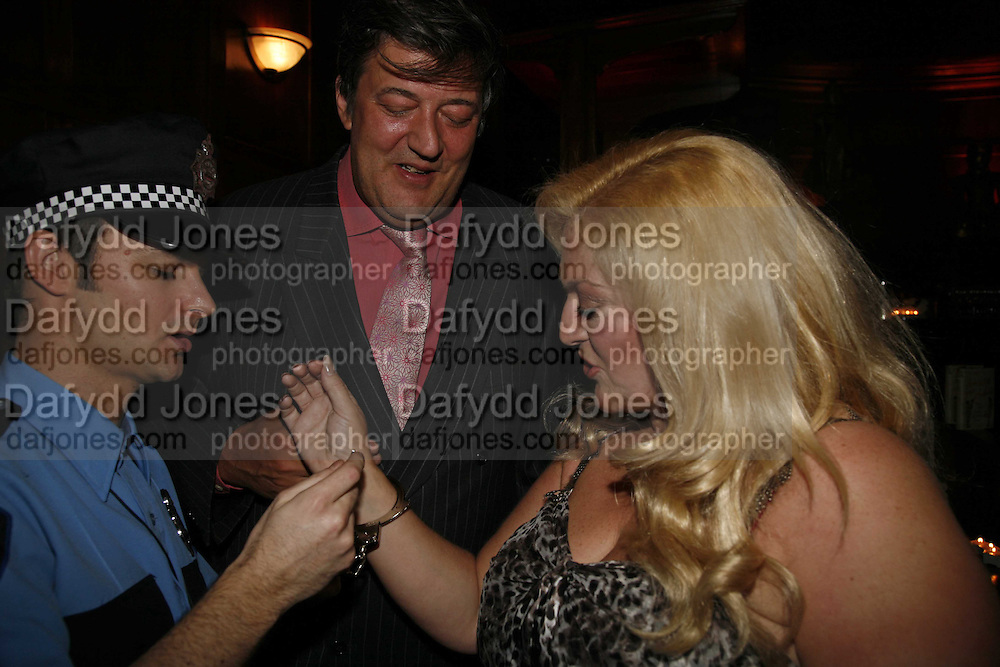 Policeman, Arron Guy, Stephen Fry and Vanessa Felt, Krug host the launch of Kathy Lette's book. ' How to Kill Your Husband' the Courthouse Hotel Great Marlborough St. London. 26 April 2006. ONE TIME USE ONLY - DO NOT ARCHIVE  © Copyright Photograph by Dafydd Jones 66 Stockwell Park Rd. London SW9 0DA Tel 020 7733 0108 www.dafjones.com