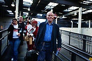 """Tony Benn MP with his trademark pipe on the peace train to Manchester, UK in 2006 with Stop the War Coalition. Anthony Neil Wedgwood """"Tony"""" Benn, (3 April 1925 – 14 March 2014), formerly 2nd Viscount Stansgate, was a British Labour Party politician who was a Member of Parliament (MP) for 50 years and a Cabinet Minister."""