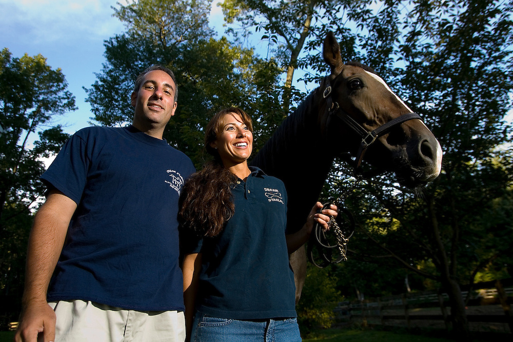 (PMONMOUTH) Colts Neck 9/112/2006  Michael and Gina Sontarp have been holding a charity dog walk at Dorbrook Park to benefit the Monmouth County SPCA. This will be the 4th annual walk. The Sontarps run Dream Stables on their property. They have 3 horses. They do pet sitting, including going to people's homes. We need pix of the couple with their horses and possibly with any dogs they care for.  Michael J. Treola Staff Photographer.....MJT