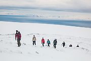 UNIS students from nearby Longyearbyen hike towards the summit of Nordenskioldfjellet, Svalbard.