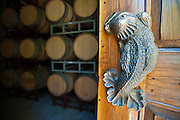 Sculpted bronze fish door handle on celler of Terra Valentine Winery, Spring Mountain wine growing district near St. Helena in California's famous Napa Valley.