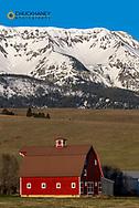 Lone Star Red barn built in 1935 with Wallowa Mountains near Joseph, Oregon, USA