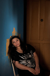 "Helena Kocková, 22, sits inside the home she shares with her family in Ostrava, Czech Republic on March 3, 2012. She was one of 18 Roma children who were represented in the D.H. and Others v. Czech Republic case, the first challenge to systemic racial segregation in education to reach the European Court of Human Rights. When this case was first brought in 2000, Roma children in the Czech Republic were 27 times more likely to be placed in ""special schools,"" intended for the mentally disabled, than non-Roma children. In 2007, the Grand Chamber of the European Court of Human Rights ruled that this pattern of segregation violated nondiscrimination protections in the European Convention on Human Rights. Despite this landmark decision, little change has occurred: the ""special schools"" have been renamed but follow the same substandard curriculum and Roma continue to be assigned to these schools in disproportionate numbers. The process of integration has barely begun."