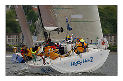Yachting- The first days racing  of the Bell Lawrie Scottish series 2003 at Gourock.  The wet start looks set to last for the overnight race to Tarbert...Mighty Moe 2 a Prima crosses behind Bataleur 97 off Gourock...Pics Marc Turner / PFM