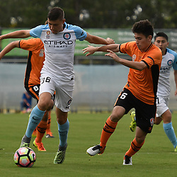 BRISBANE, AUSTRALIA - DECEMBER 3: Dylan Pierias of the City dribbles the ball under pressure from Joe Caletti of the Roar during the round 4 Foxtel National Youth League match between the Brisbane Roar and Melbourne City at AJ Kelly Field on December 3, 2016 in Brisbane, Australia. (Photo by Patrick Kearney/Brisbane Roar)