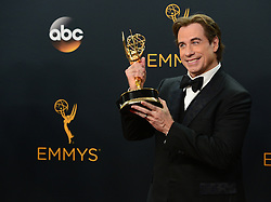 September 18, 2016 - Los Angeles, California, U.S. - JOHN TRAVOLTA poses backstage with his Award for Outstanding Limited Series at the 68th Annual Emmy Awards. (Credit Image: © Michael Owen Baker/Los Angeles Daily News via ZUMA Wire)