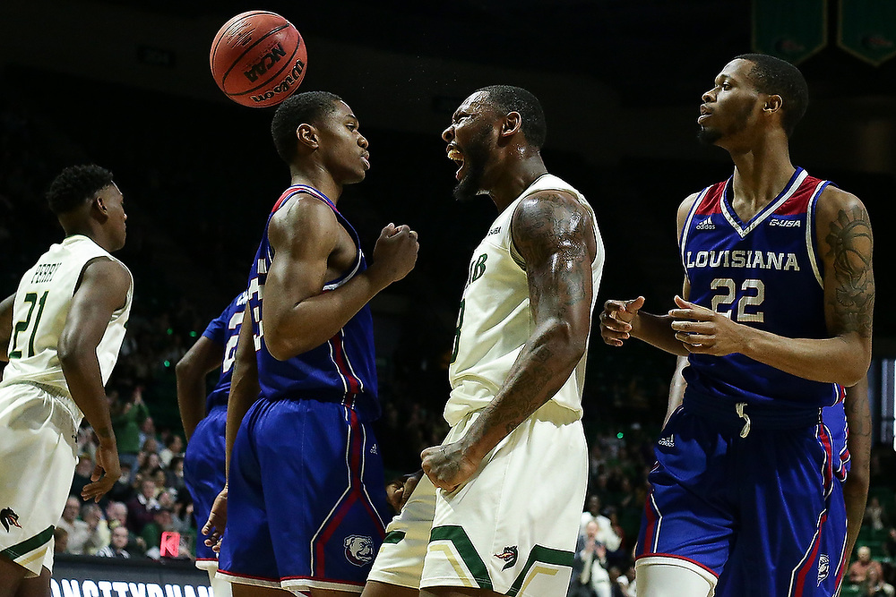 UAB's Chris Cokely (3) celebrates dunking the ball during the game against La. Tech. <br /> UAB Blazers vs La. Tech Bulldogs at Bartow Arena in Birmingham, Ala. on Saturday, Jan. 13, 2018.<br /> Zach Bland/UAB Athletics