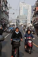 China, Shanghai. Hongkou and north shanghai area. pedestrians and vehicles .old bridge on Wusong river