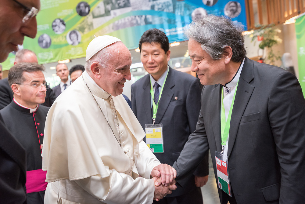"""21 June 2018, Geneva, Switzerland: Preceding an Ecumenical Encounter between Pope Francis and the World Council of Churches, Pope Francis greets a delegation to the WCC from North Korea and South Korea. On 21 June 2018, the World Council of Churches receives a visit from Pope Francis of the Roman Catholic Church. Held under the theme of """"Ecumenical Pilgrimage - Walking, Praying and Working Together"""", the landmark visit is a centrepiece of the ecumenical commemoration of the WCC's 70th anniversary. The visit is only the third by a pope, and the first time that such an occasion was dedicated to visiting the WCC."""