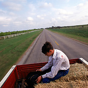 A young man sits in the back of his father's truck as they work their way to their crops near the border in Del Rio, Texas. An increase in migrant smugglers using the area resulted in the father not wanting to let his son out of sight. Please contact Todd Bigelow directly with your licensing requests. PLEASE CONTACT TODD BIGELOW DIRECTLY WITH YOUR LICENSING REQUEST. THANK YOU!