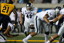 Nevada kicker Brandon Talton (43) boots 50-yard field goal against California out of the hold by Julian Diaz (49) during the third quarter of an NCAA college football game, Saturday, Sept. 4, 2021, in Berkeley, Calif. (AP Photo/D. Ross Cameron)