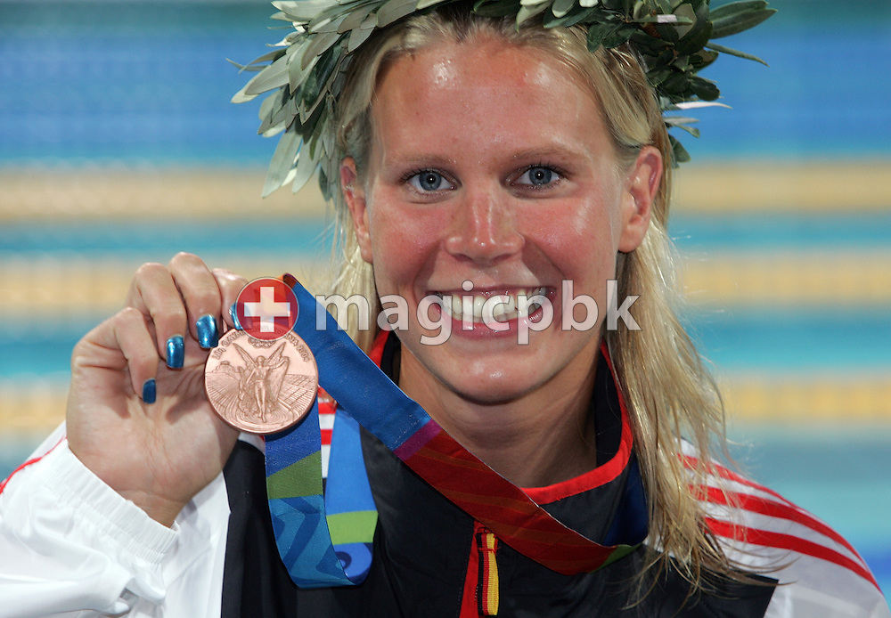 Anne Poleska of Germany poses with her bronze medal after she finished third in the women's swimming 200 metre breaststroke final held at the National Aquatics Center at the Athens 2004 Summer Olympic Games in Athens, Greece, Thursday, Aug. 19, 2004. (Photo by Patrick B. Kraemer / MAGICPBK)