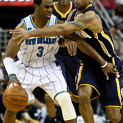 April 3, 2011; New Orleans, LA, USA; New Orleans Hornets point guard Chris Paul (3) is defended by Indiana Pacers shooting guard Dahntay Jones (1) during the fourth quarter at the New Orleans Arena. The Hornets defeated the Pacers 108-96.  Mandatory Credit: Derick E. Hingle