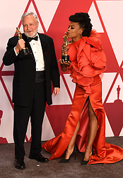 Jay Hart (left) and Hannah Beachler with the award for best production design for Black Panther in the press room at the 91st Academy Awards held at the Dolby Theatre in Hollywood, Los Angeles, USA