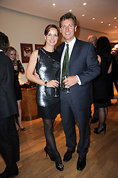The Ruinart Champagne Christmas drinks party held at Berluti, Conduit Street, London on 9th December 2009.<br /> Picture shows:- DARCEY BUSSELL and ANGUS FORBES *** Local Caption *** Image free to use for private use.  If in doubt contact us - info@donfeatures.com