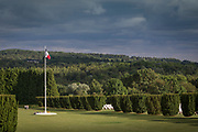 French flag at cemetery under overcast sky, Verdun, France
