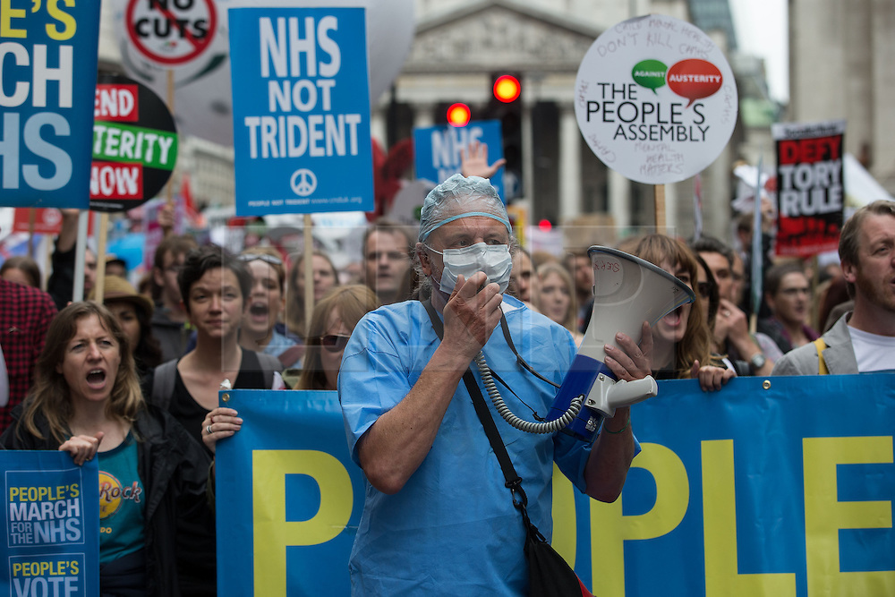 © Licensed to London News Pictures . 20/06/2015 . London , UK . NHS workers on the march . Tens of thousands of people march from the Bank of England to Parliament , to protest economic austerity in Britain . Photo credit: Joel Goodman/LNP