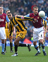 Photo: Dave Linney.<br />Aston Villa v Port Vale. The FA Cup. 28/01/2006.Aston Villa's Olof Mellberg (R) fends off the challenge from  Leon Constantine