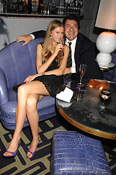 ISABELLE VOSPER and DR GEZA TOTH-FEHER at a party to promote The Landau at The Langham, Portland Place, London W1 on 7th February 2008.<br />